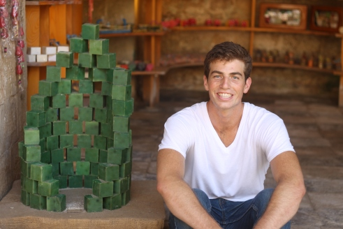 my friend Matt with a pile of cedar-scented soap