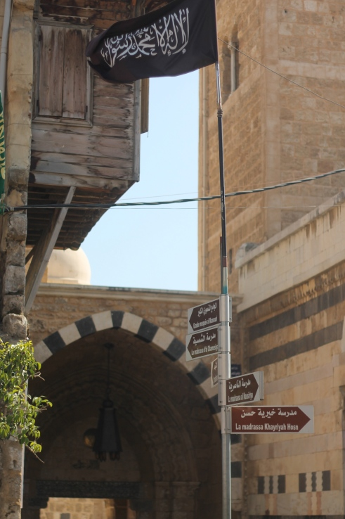Al Qaeda flag at the entrance to the Grand Mosquée